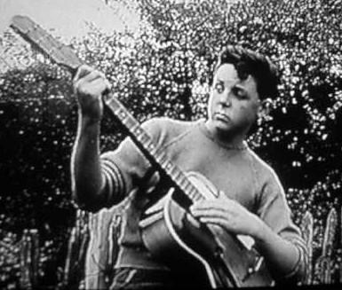 Boy w Guitar, Damaged Face